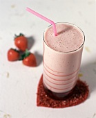 Strawberry smoothie on heart-shaped coaster