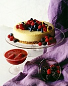 Cheesecake with mixed berries; strawberry puree