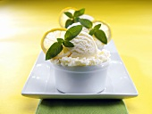 Lemon ice cream with mint leaves and slices of lemon