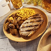 Grilled Pork Loin Chop with Roasted Potatoes and Corn