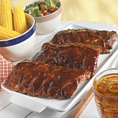Three Racks of BBQ Baby Back Ribs with Corn and Salad