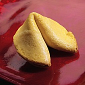 A Fortune Cookie on a Red Background