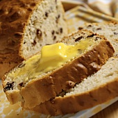A Slice of Warm Raisin Soda Bread with Melting Butter