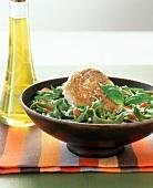 Tuna steak with spinach fettuccine in a bowl
