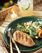 A Grilled Chicken Breast with Avocado Salad