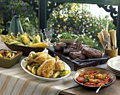 Rustic summer buffet with steaks and roast chicken