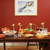 A Buffet Table with Pasta, Salad, Popovers, Pie and Red Wine