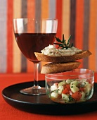 Tapas (White Bean Spread and Cucumber and Tomato Salad) with Red Wine