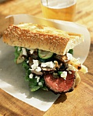 Sliced Steak and Feta on a Baguette