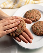 Hands Forming Turkey Burgers