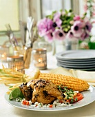 Roast chicken with corncob and rice salad