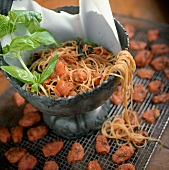 Overflowing Spaghetti and Tomato Sauce in Metal Bowl