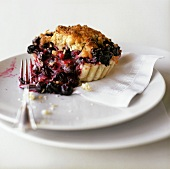 Blueberry Lime Tart on a Plate with a Fork