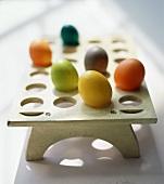 Coloured eggs on egg holder