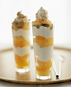 Two orange trifles in tall glasses