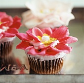 A Cupcake with Pink Flower Petals