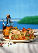 Tuna with Citrus Salsa and Olive Oil on a Table by the Water