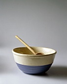 A Blue and White Mixing Bowl with a Metal Spoon