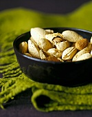 Almonds, In and Out of the Shell, in a Black Bowl