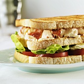A Lobster Sandwich on Toasted Bread with Lettuce and Tomato