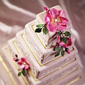 A Multi-tiered Wedding Cake with Pink Flowers