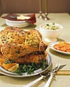 A Stuffed Turkey on the Table with Side Dishes