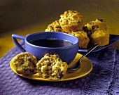 Raisin muffins and cup of black coffee