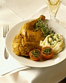 Half a chicken with mashed potato and tomato gratin