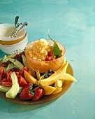 A Bowl of Cantaloupe Granita on a Platter with Fresh Melon Wedges and Berries