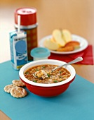 Hearty Alphabet Soup with Grated Parmesan, Crackers and Milk