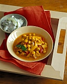 Chick-pea and tomato curry with cucumber raita