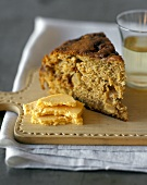 Piece of apple cake and Cheddar on chopping board