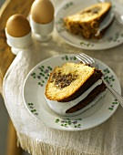 Piece of ring cake with nut filling and icing for breakfast