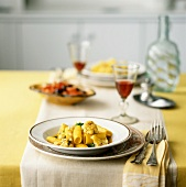 Curried ziti, capers and cauliflower on a laid table