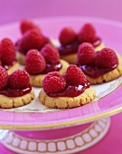 Butter Cookies with Raspberry Jelly Topping and Fresh Raspberries