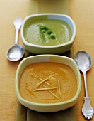 Carrot soup and pea soup in square soup bowls