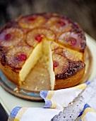 Pineapple cake, a piece cut