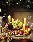 A Festive Holiday Centerpiece Filled with Fruit and Candles