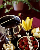 Chocolate fondue with fruit, cake and biscotti