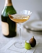 A Glass of Pink Champagne with Figs