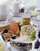 Assorted Cheeses on a Tray with Figs and Crackers