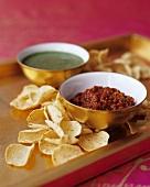 Tomato salsa and salsa verde with crisps