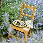 Fresh figs on wooden chair in a lavender field