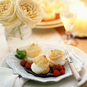 Cream Puffs with Raspberries in Chocolate Sauce