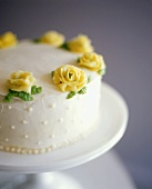Birthday cake with yellow marzipan roses