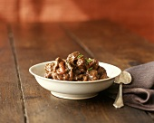 Beef ragout in white bowl