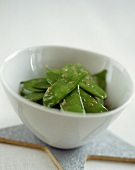 A Bowl of Snow Peas in Peanut Sauce on a Star