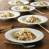 Bowls of Fettucini with Parmesan Cream Sauce, Sliced Ham and Spinach