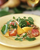 Salad with yellow beetroot, nuts and orange segments