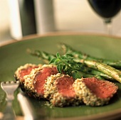 Herb Encrusted Sliced Tenderloin with Roasted Asparagus